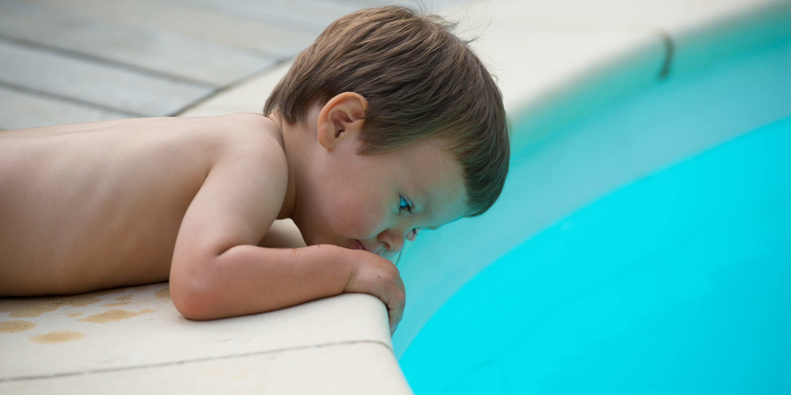 Child beside the pool